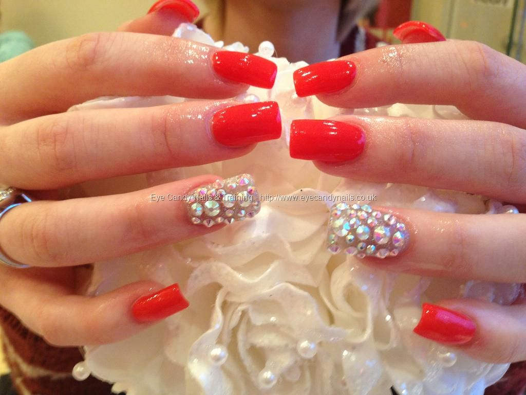 Acrylic nails with red gelish gel polish and swarofski crystals on top of silver gelux glitter on ring fingers