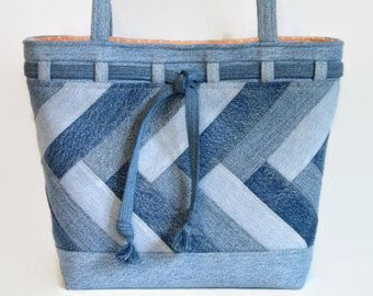 Extra Large Denim Tote bag, handbag or shoulder bag/purse made out of a variety of upcycled recycled repurposed denim blue jeans and cotton fabric was used to create this unique Crazy Quilt patchwork bag. This extra large size bag is perfect for carrying all your daily needs, books, magazines or projects. Use it as a travel bag, overnight bag or beach bag. Add a favorite pin to coordinate with your outfit. The exterior of this blue jean tote bag was constructed with a variety and shades ...