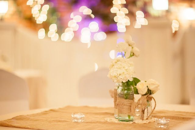 Easy frayed burlap tied with twine in a bow around a vase/Mason jar