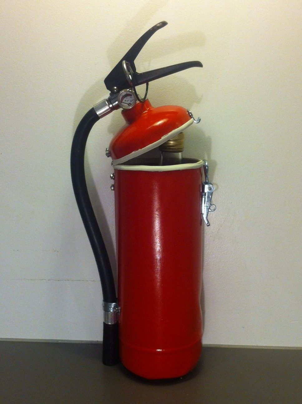 Fire extinguisher upcycled into liquor container fire
