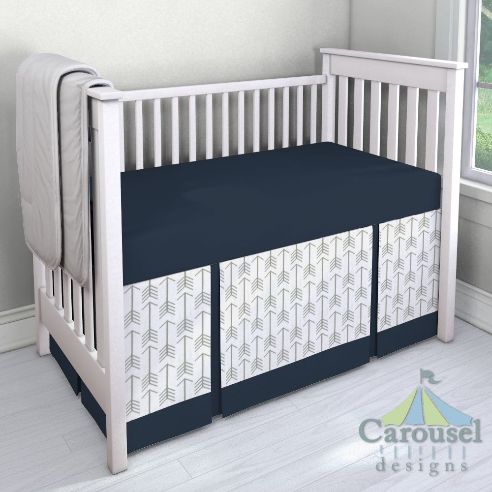 Crib bedding in White and Gray Arrow, Solid Navy. Created using the Nursery Designer® by Carousel Designs where you mix and match from hundreds of fabrics to create your own unique baby bedding. #carouseldesigns