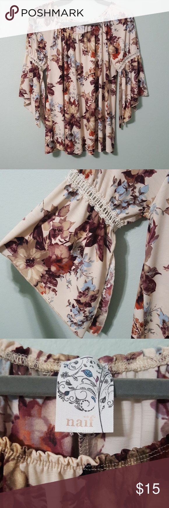 Naif floral blouse with bell sleeve EUC Naif floral blouse with bell sleeves. I believe it is a large, the size tag is missing but measurements are in…