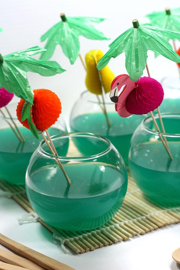 Aqua Fishbowl Dessert Cocktails      WHAT YOU'LL NEED:   12 oz. vodka  6 oz. blue curacao  6 oz. coconut rum  12 oz. pineapple juice  6 oz. sweet and sour mix  6 oz. lemon-lime soda  5 packets unflavored gelatin