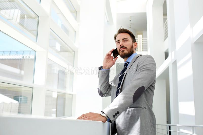 Portrait Of A Young Successful Businessman Speaking On The Mobile