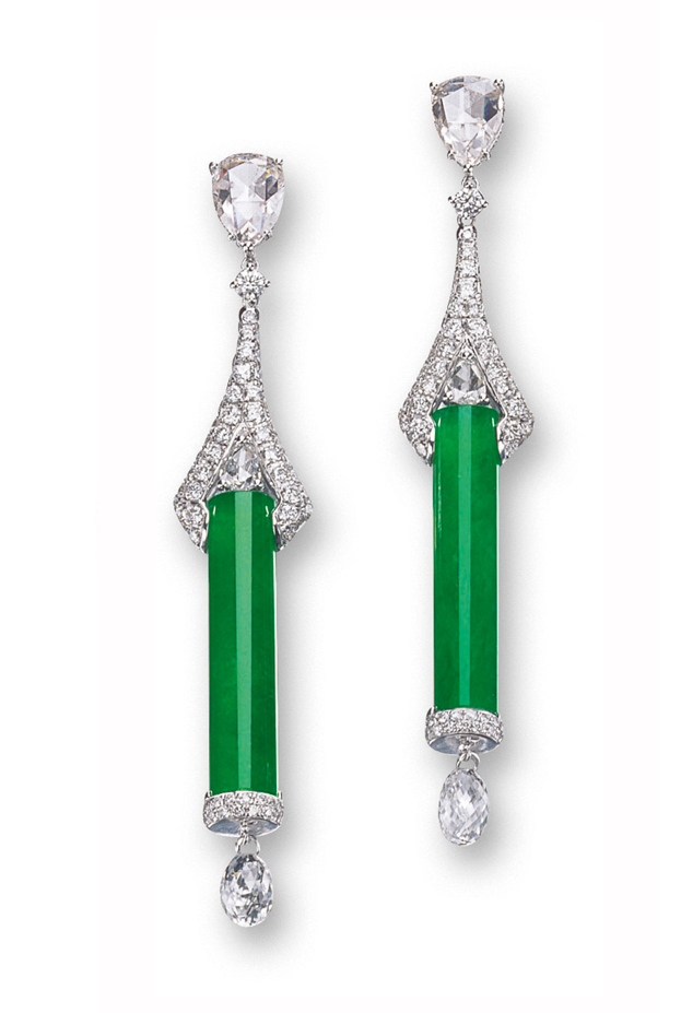 Jadeite and diamond earrings. Each set with a highly translucent bright emerald green jadeite cylinder, suspending an articulated briolette diamond, surmounted by brilliant-cut and pear-shaped rose-cut diamonds, joined by a pavé-set brilliant-cut diamond claw, mounted in 18 karat white gold.