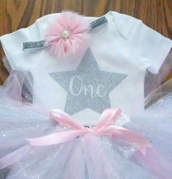 Girls Birthday Outfit. You have the choice of all 3 pieces (tutu, onesie and headband/clip), tutu with onesie, or tutu with headband/clip.  NOTE: Outfit automatically comes with a headband. If you would like the headband to be a clip instead, please add that to your notes.  Tutu colors pictured are white tulle, light pink tulle, blue tulle, and silver sparkle tulle.  ***TUTU DOES HAVE LOOSE GLITTER***  If you pick the option without a size and do not put a size in the notes section,...