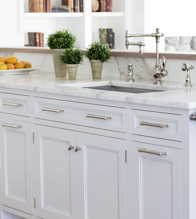 Crisp White Kitchen Cabinets With Marble Countertops And