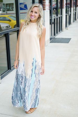 Steal the show in this elegant printed maxi dress! It has a trendy high neck with a sheer overlay that makes it totally stunning!