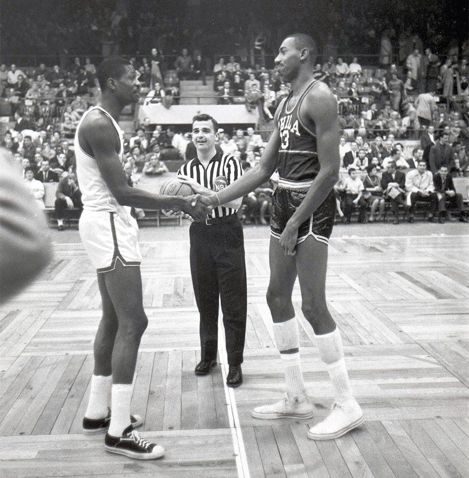 Bill Russell and Wilt Chamberlain shake hands before their first NBA game  against one another 93859bf74