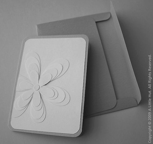 handmade card ... gray base ... beautiful white multi-layered flower ... luv the pyramid style layered petals ... great card!