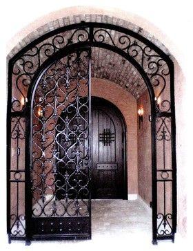 Front entry mediterranean old world mediterranean - Interior decorative wrought iron gates ...