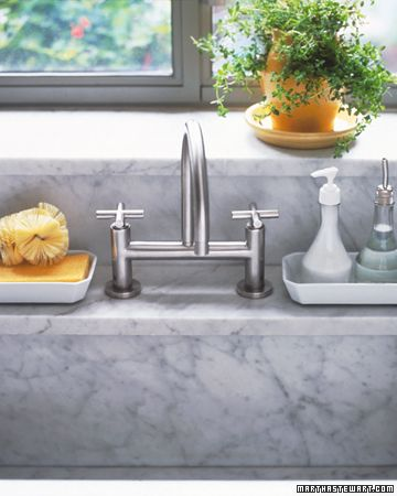 pretty sink organizing (ps dish soap is in glass bottle with spout