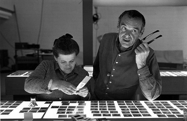 Charles Eames - Master Designer using tools of his trade: slides, lightbox and his imagination.