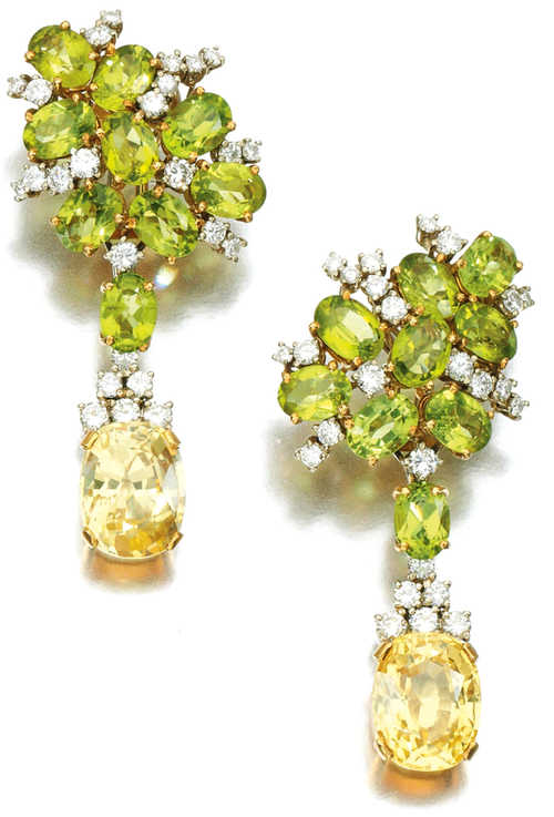 Pair of peridot, yellow sapphire and diamond pendent earrings.     Each designed as a cluster of oval peridots accented with brilliant-cut diamonds, suspending an oval-shaped yellow sapphire drop, clip fittings. Via Sotheby's.