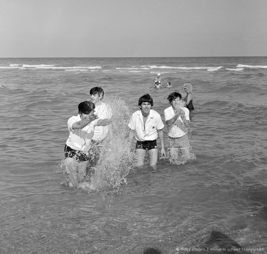 The Beatles enjoy the sun at Miami Beach, Florida. The Band was in Florida to appear on THE ED SULLIVAN SHOW at the Deauville Hotel.