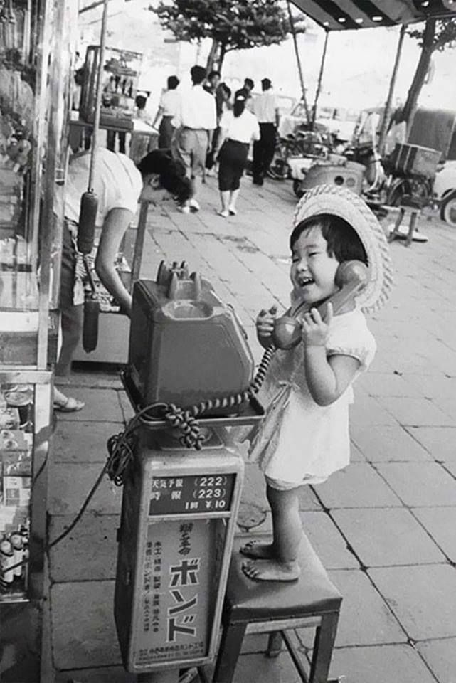 A Little Girl Having Fun Pretending To Talk On The Telephone, Japan, 1958 Check this blog!