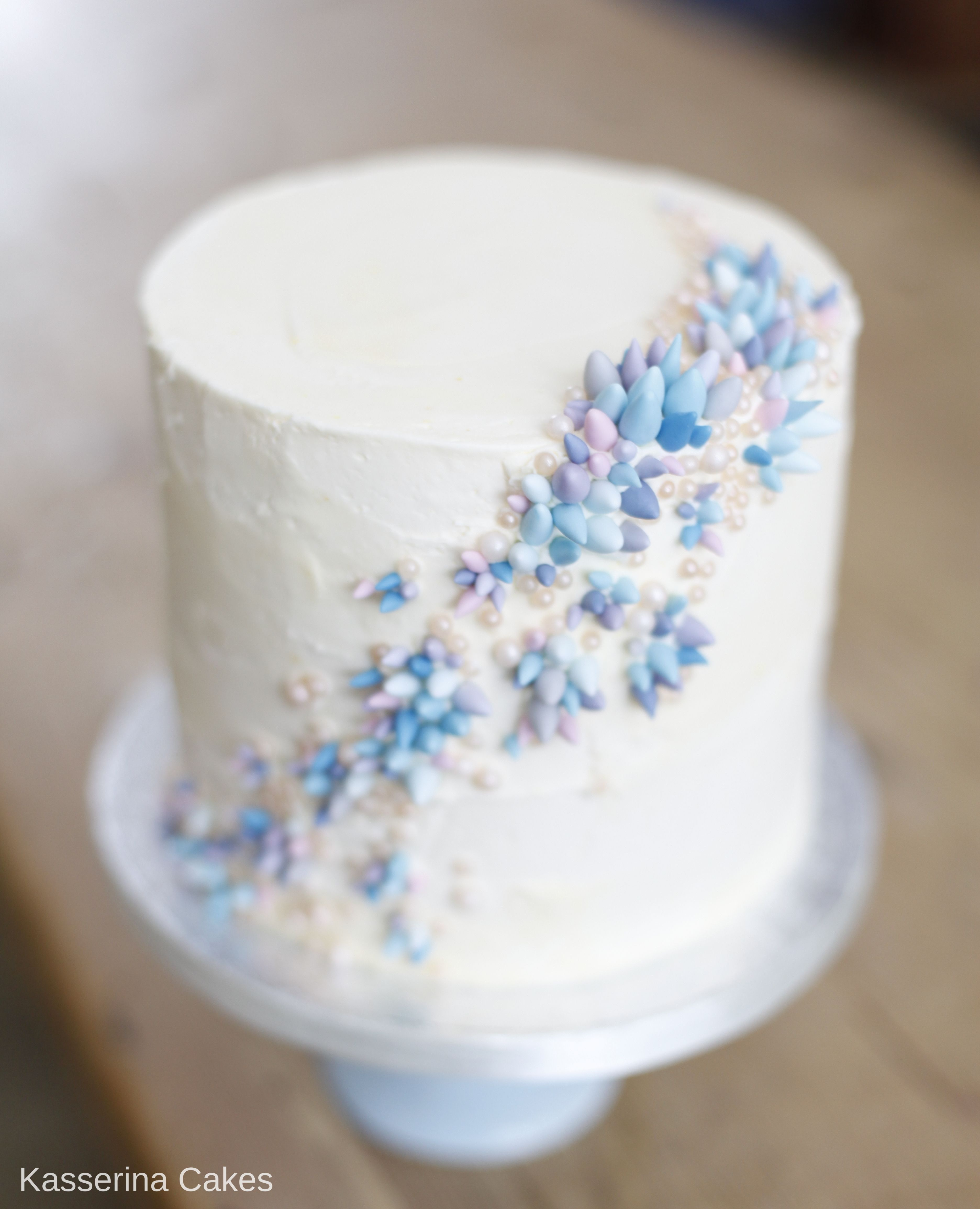 Coral inspired cake with a burst of blue purple and pink sugar