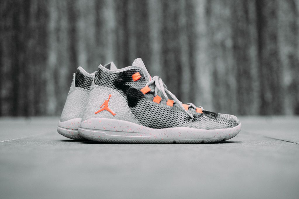 515ba200774d The Jordan Reveal Premium is introduced in a new colorway of wolf  grey orange