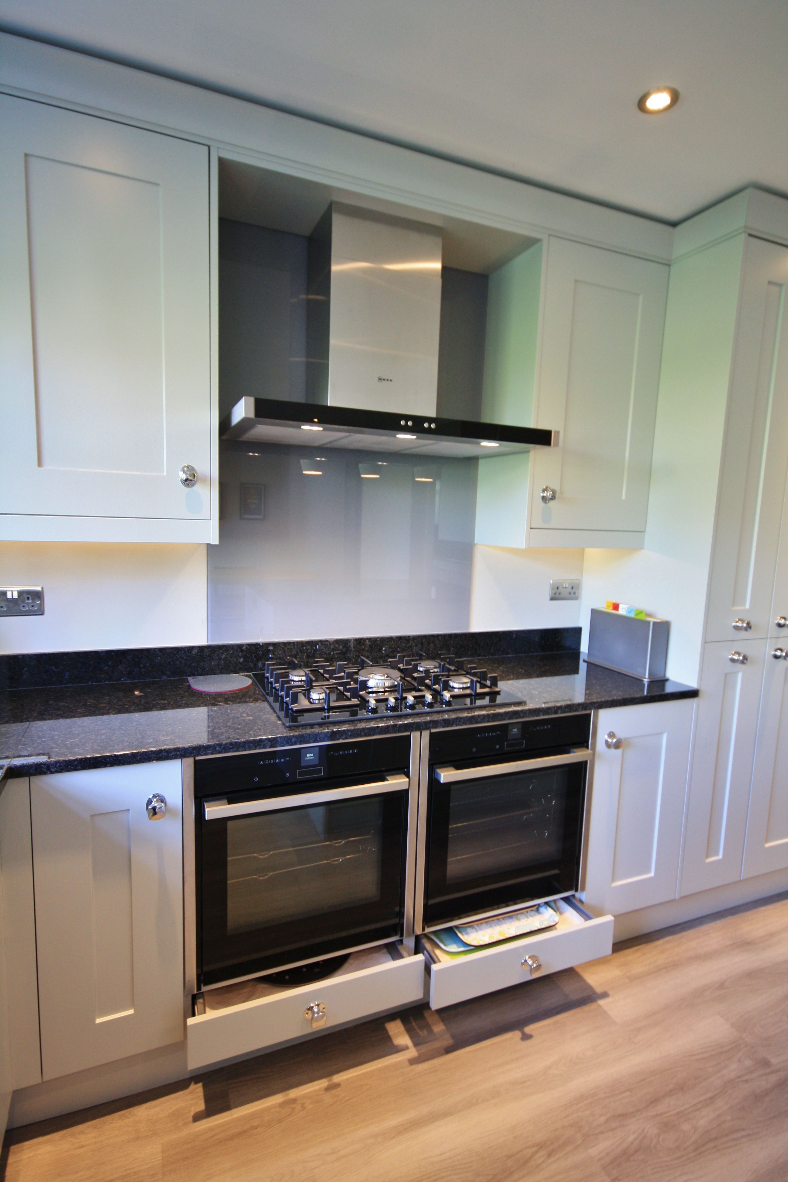 2 Neff Slide Hide Pyrolytic Ovens And Neff Extractor Hood With Storage Drawers Below And A Slate Grey Glass Spl Kitchen Cooker Kitchen Interior Kitchen Design