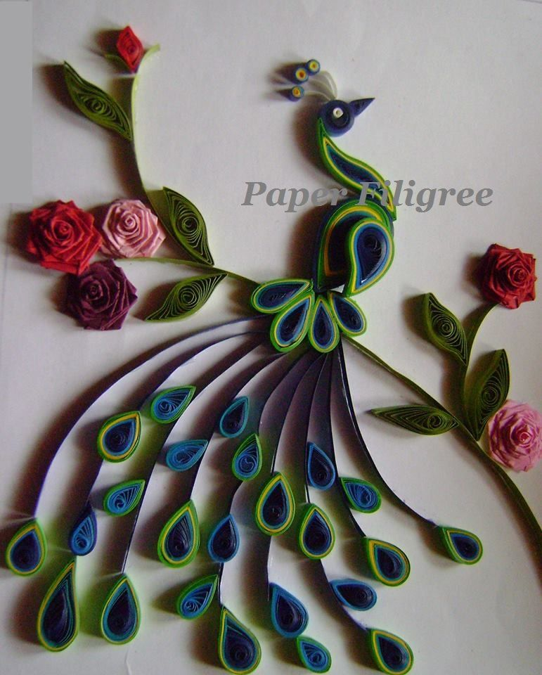 an elegant paper quilled peacock is a picture frame which