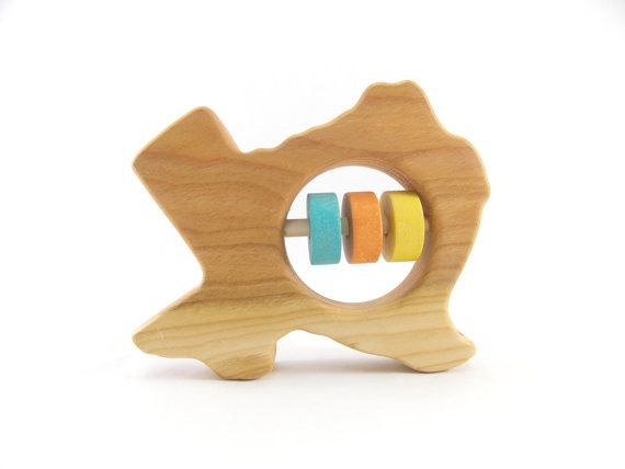 Organic Baby Rattle – Cherry Texas State Shape    What a great modern gift to give as a keepsake! An organic, all natural wooden rattle in the shape