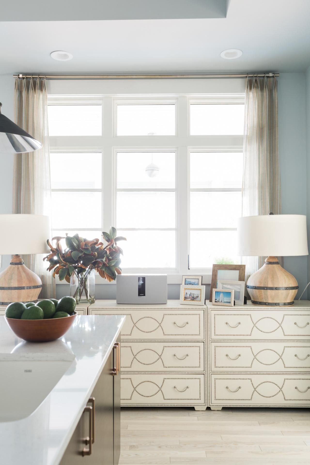 chests of drawers on a far wall creates storage, but saves money on ...