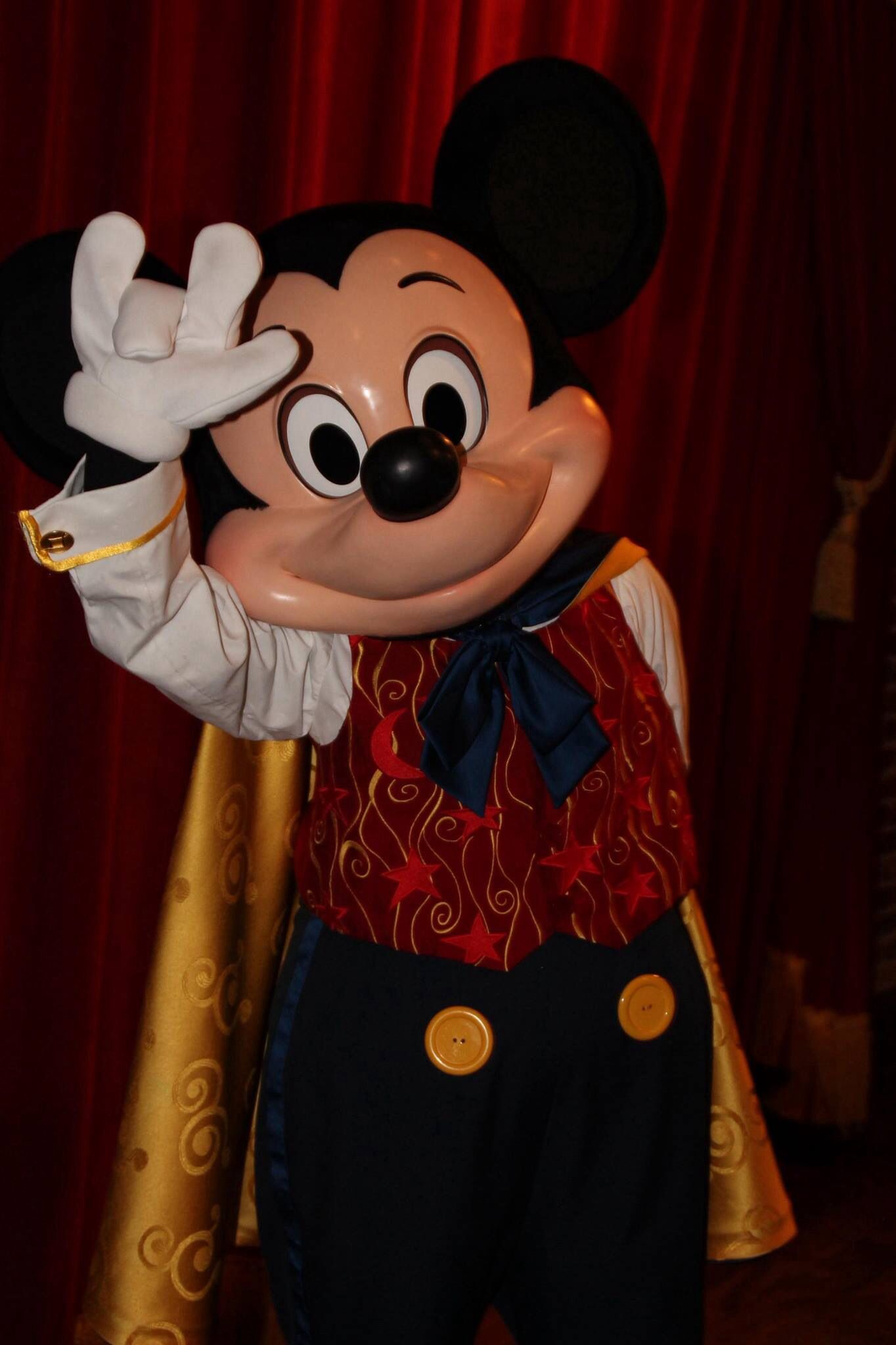 mickey mouse is saying rock on in the magic kingdom mickey mouse