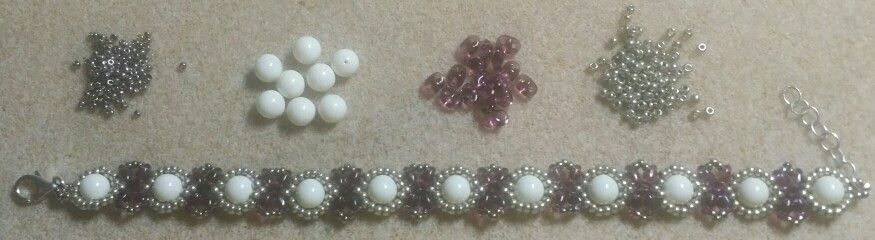 This is a Honey Beads1 tut...used 6mm swarovski crystal ivory beads, 11°'s and 15°'s insteads of 8's, 8°s and 11°'s.  Used the same counts just smaller beads.