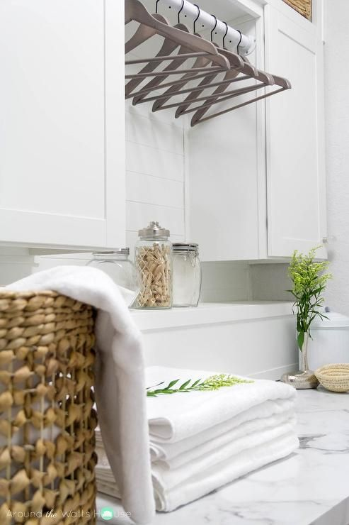 white laundry room features a calacatta marble like formica laminate countertop lowes formica brand laminate
