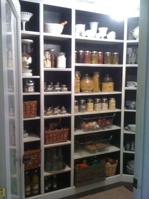 Pantry on a budget - Ikea Billy shelves with added trim. Hmm. . . wonder if sliding door would work on this?