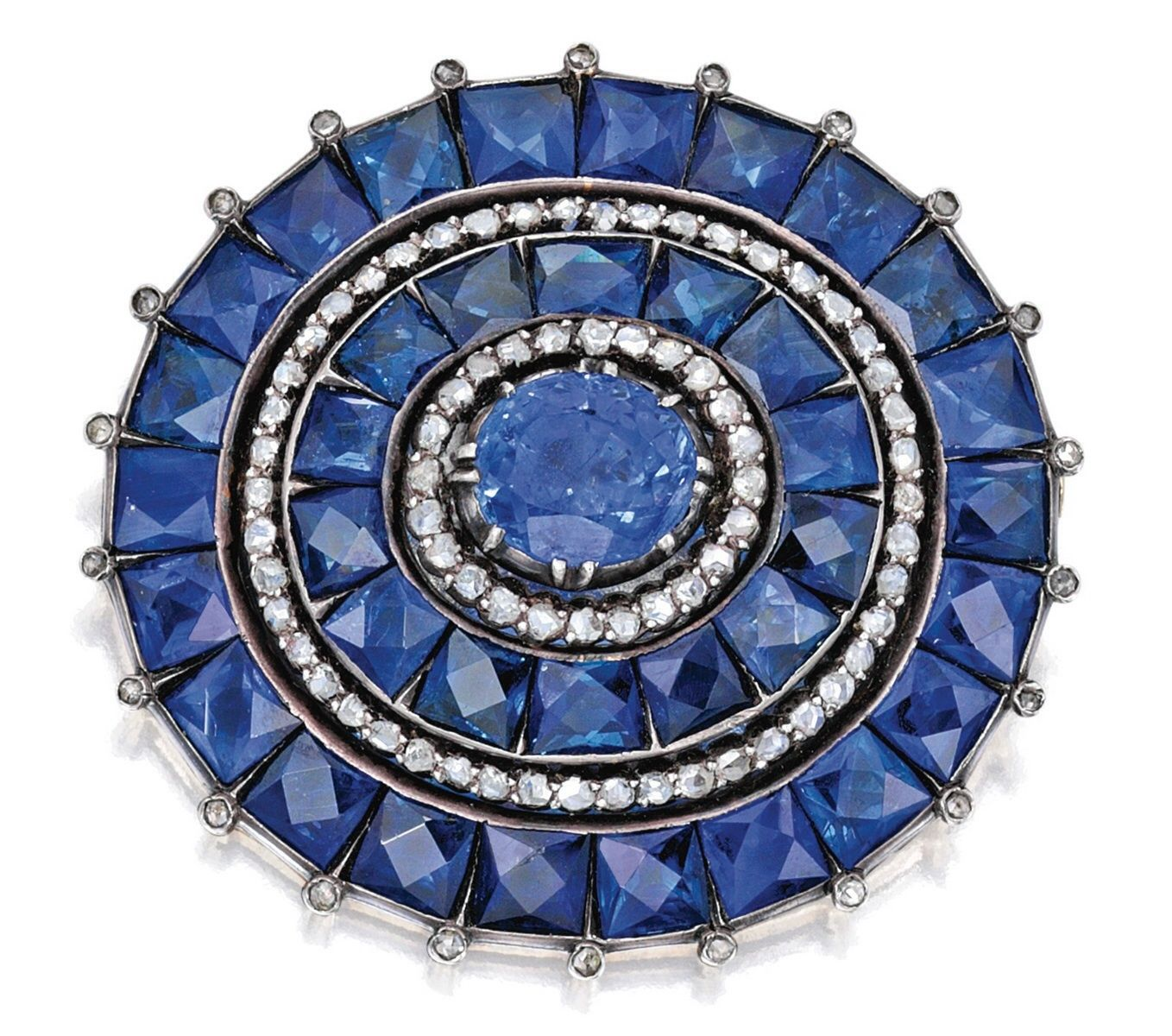 GOLD, SILVER, SAPPHIRE AND DIAMOND BROOCH - Centered by an oval-shaped sapphire weighing approximately 6.25 carats, framed by 36 French-cut sapphires weighing approximately 17.75 carats, accented by rose-cut diamonds weighing approximately .65 carat; last quarter of the 19th century.