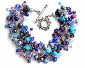 blue and purple bracelet. beaded bracelet. charming lapis and amethyst gift with lots of beads.