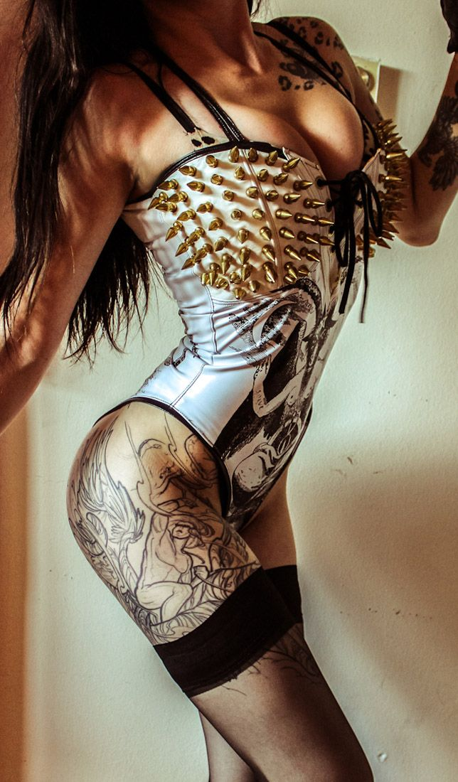 Erotic girls in leather with body piercing