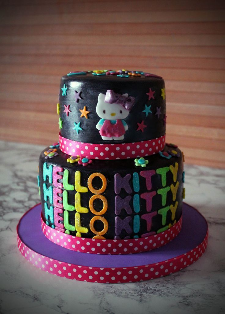 Check out this Hello Kitty black and neon birthday cake So cute