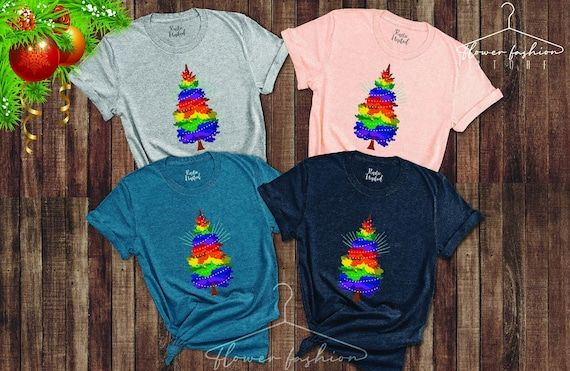 LGBT Pride Christmas Tree Shirt,Gay Christmas Gifts,Rainbow Shirt,Lesbian Pride Tee,LGBT Xmas Shirt, Rainbow Flag Tee, Gay Christmas Apparel---How To Order ---1-) Please, check and review all photos2-) Choose your t-shirt size and color*Different styles of shirts may have different shades of same color choice due to different manufacturer brands.*For this reason, we recommend you to match shirts from the same styles if you want precisely matching colors (ex. Unisex, V-neck, Tank top, etc.).3-) C