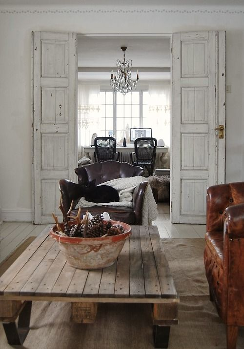 ::Love the idea of old shutters or french doors on either side of this doorway . . . gives it a feeling of prominence. ♥