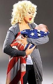 I think this might be Christina Aguilera, and I really like it! Super cute for a new military mom!