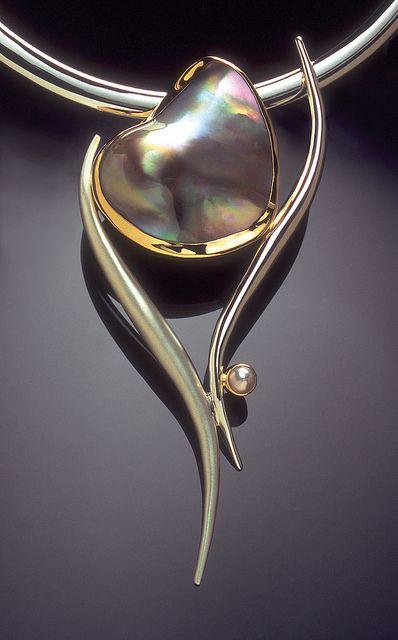 """""""Dancing Heart"""" pendant by Jody Ochs. Freshwater mabe pearl, sterling silver, 22k gold."""