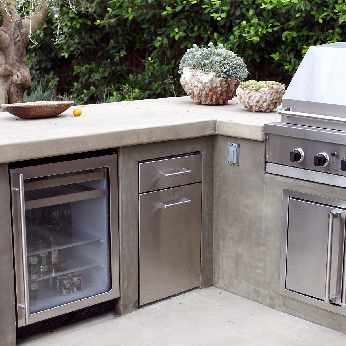 An outdoor fridge is an essential for a high end built in for Backyard built in bbq ideas