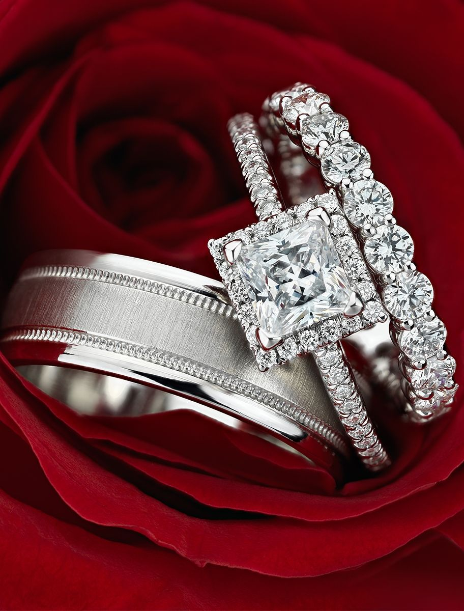 Let love bloom this Valentine's Day! This stunning Princess Cut Halo Engagement Ring is set in enduring platinum.