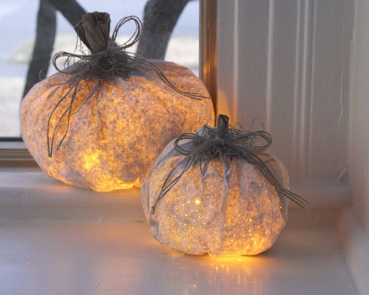 Here are instructions for how to make paper bag pumpkin luminaries - decorations to make for halloween