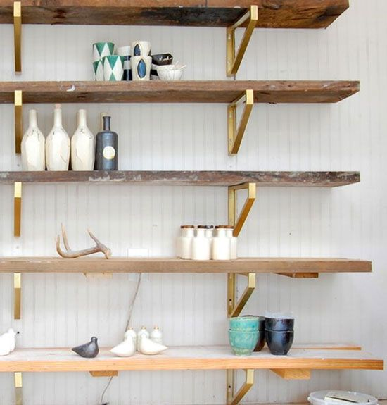 chic ikea hacks these brass brackets with paired with reclaimed wood shelves make a stunning wall shelving unit