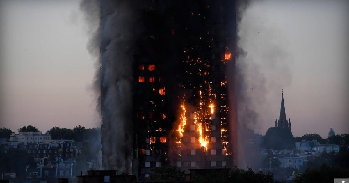 Pedestrians look up towards Grenfell Tower a residential block of flats in west  Pedestrians look up towards Grenfell Tower a residential block of flats in west London on...