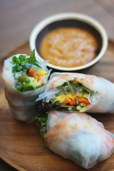 Spring rolls: gulf prawns, rice paper wrappers, carrots, cucumber, mango, rice vermicelli, mint, thai basil, cilantro, salt; (crunchy peanut butter, hoisin, lime juice, soy sauce, sugar, chili paste, sesame oil)