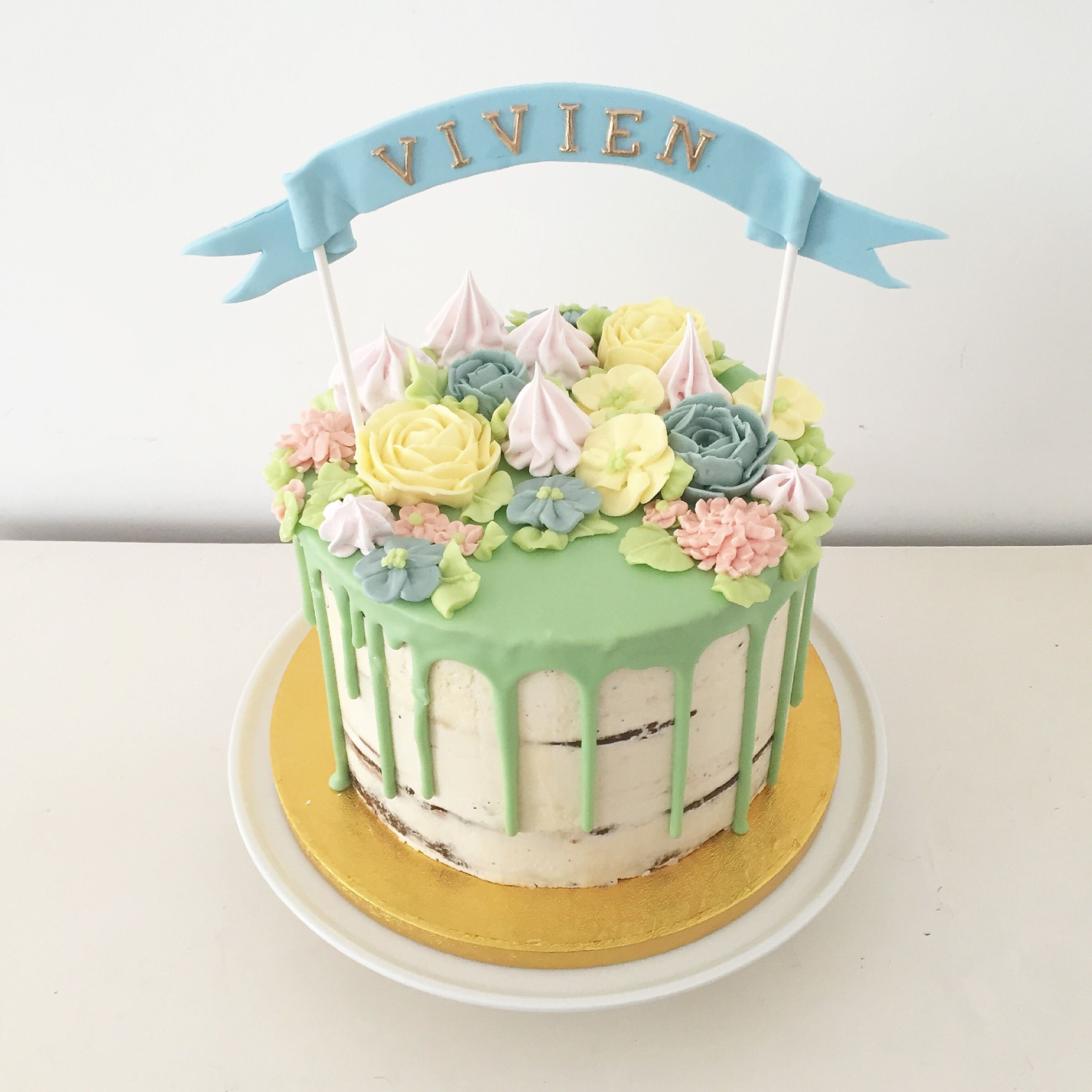 Buttercream flowers seminaked birthday cake with ribbon name topper