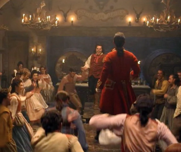 "And here's footage of live-action Le Fou (played by Josh Gad) and towering Gaston (played by Luke Evans) singing the ""Gaston"" song."" 