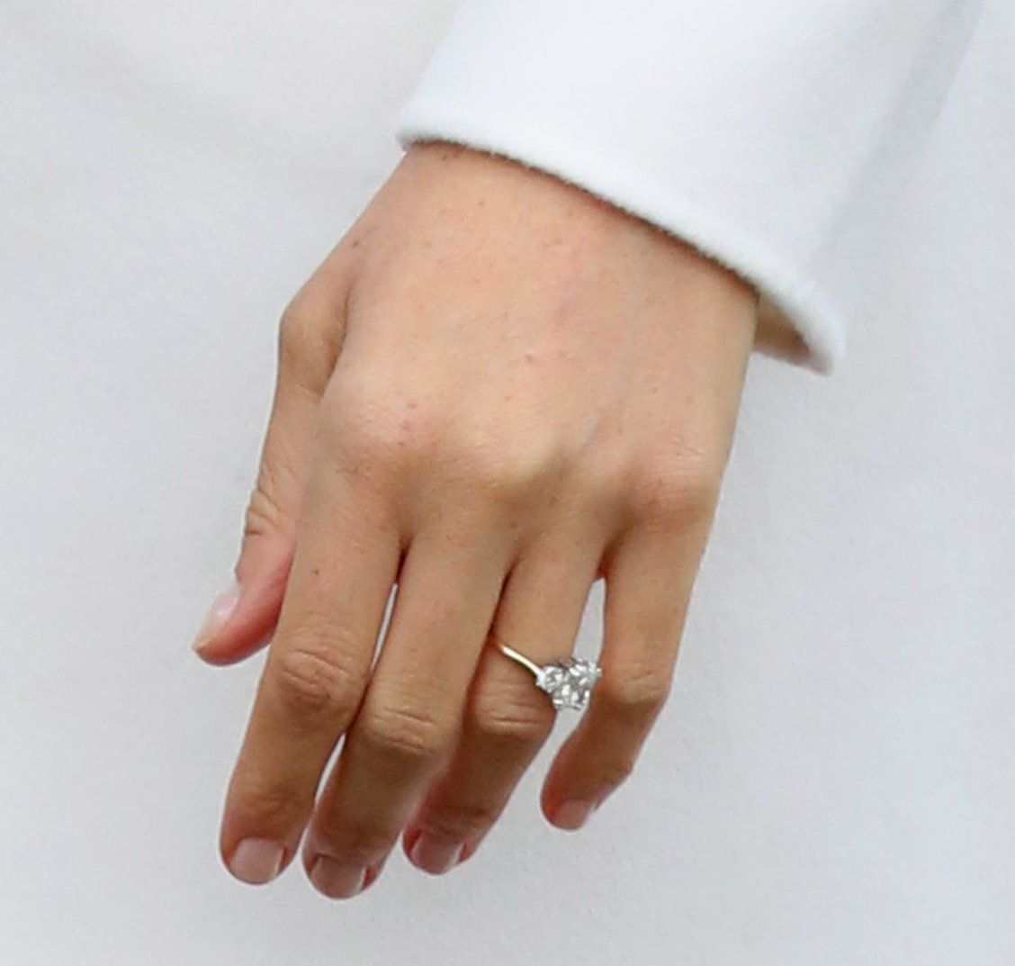 Meghan markle s engagement ring is worth this much for Wedding ring tattoos cost