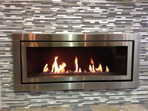 A more contemporary modern fireplace, with tile surround. I know ...