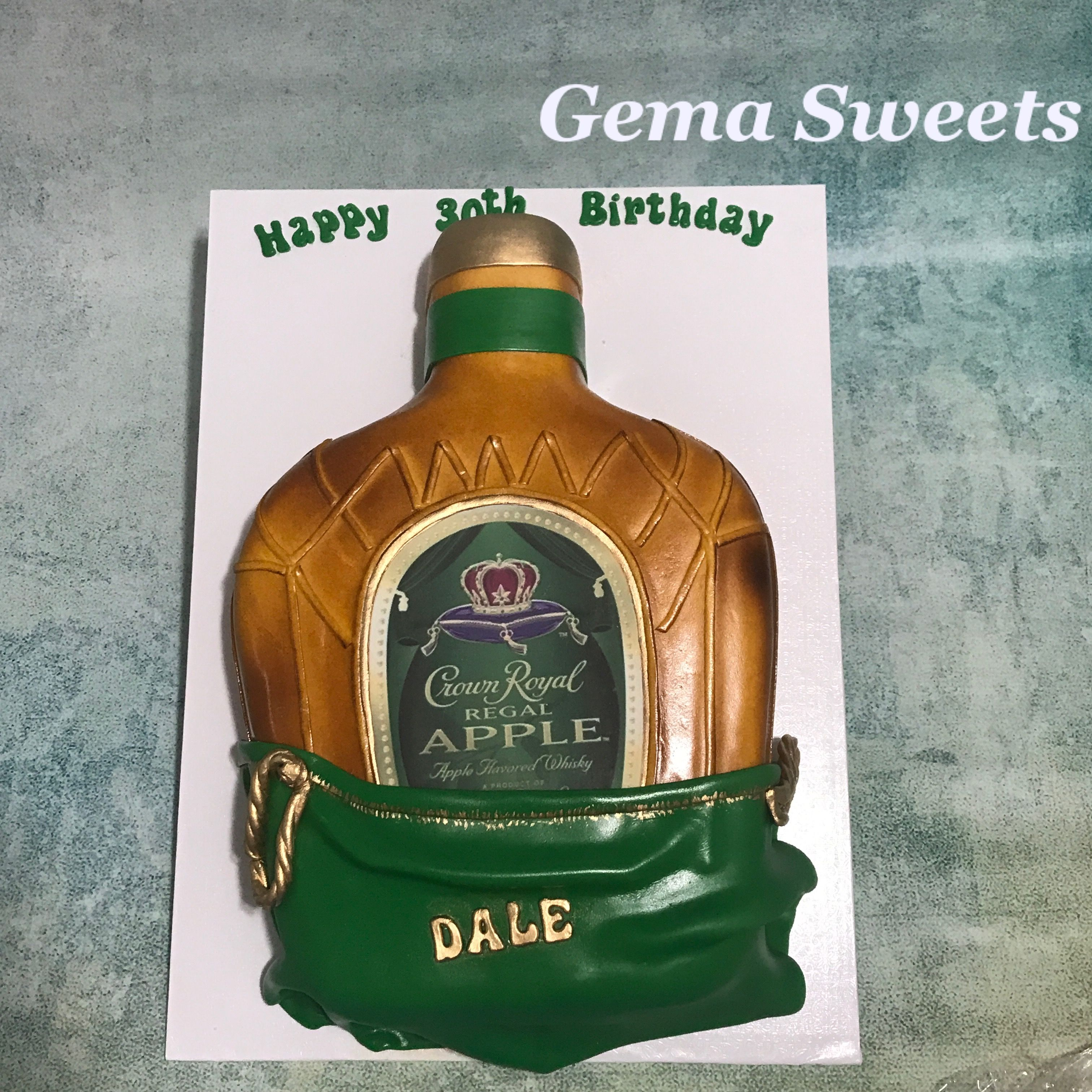 Crown Royal Regal Apple whiskey bottle cake by Gema Sweets.