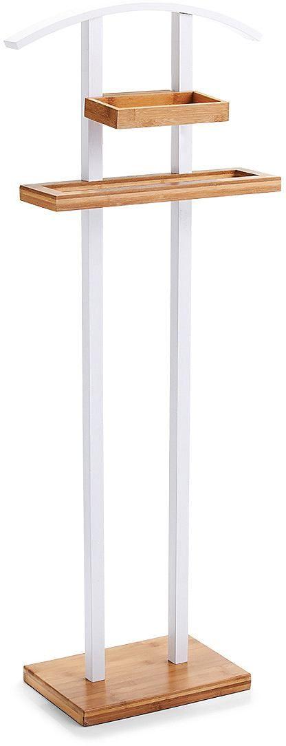 Dieser Herrendiener aus edlem Bambusholz besticht nicht nur durch seinen hohen Nutzfaktor sondern auch durch seine erstklassige Optik. Er verfügt über einen Jackethalter, ein großzügig dimensioniertes Ablagefach sowie einen Hosen- und Krawattenhalter. Dank seiner hochwertigen Lackierung steht auch einem dauerhaften Einsatz im Bad nichts entgegen.  Artikeldetails:  Jackethalter, Mit praktischem ...